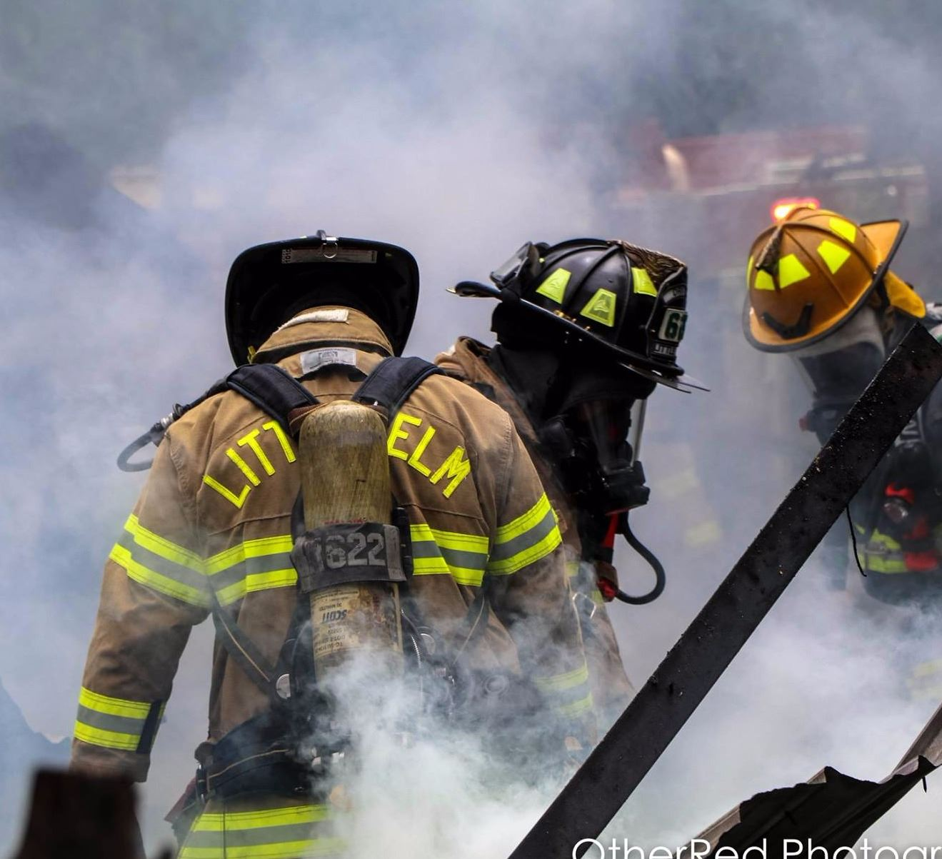 Firefighters in the smoke