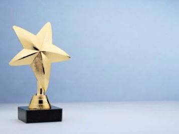 star-shaped-golden-trophy-for-rewarding-in-4JC6SP9-400x268